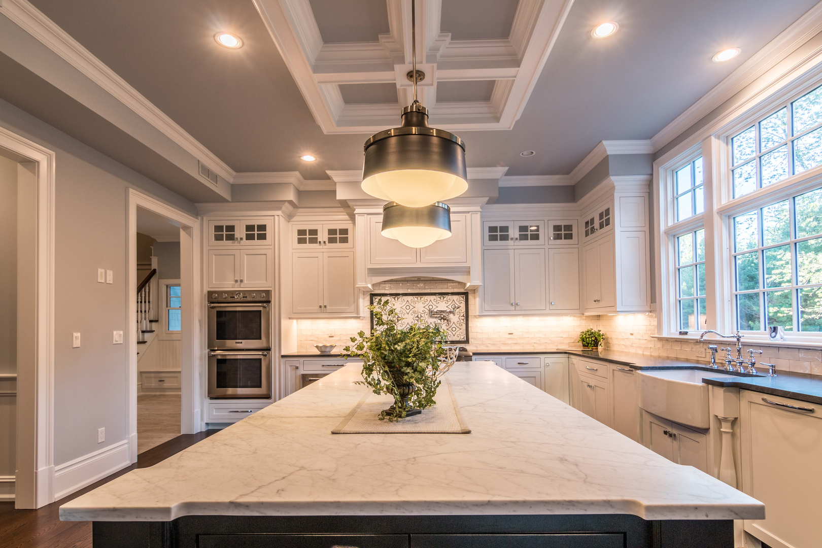 Natural Stone Countertops with Beautiful Marble Mural Design on Backsplash.