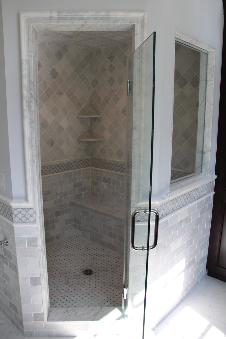 3×6 and 4×4 Tumbled Carrara Marble shower