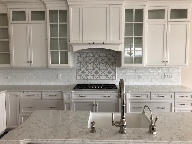 White Subway Tile With Marble Design Behind Stove Quartz Countertop Imperial Tile