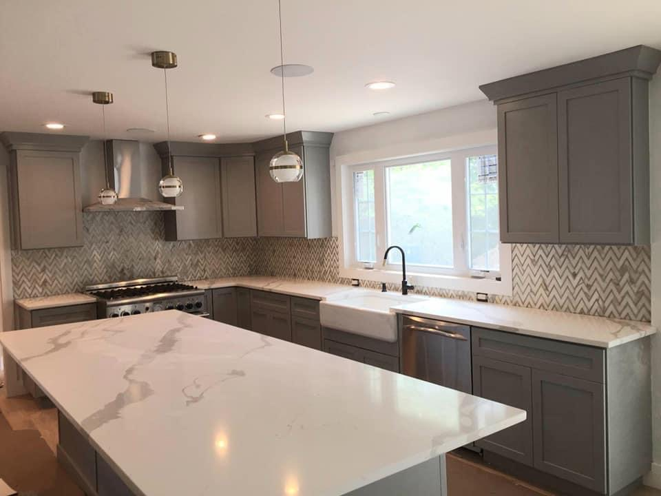 Quartz Countertop with Marble herringbone Backsplash