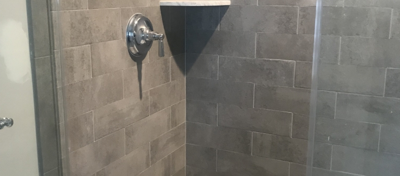 Porcelian grey 4×14 Tile with 2×2 Asian Statuary hexagon marble shower Floor