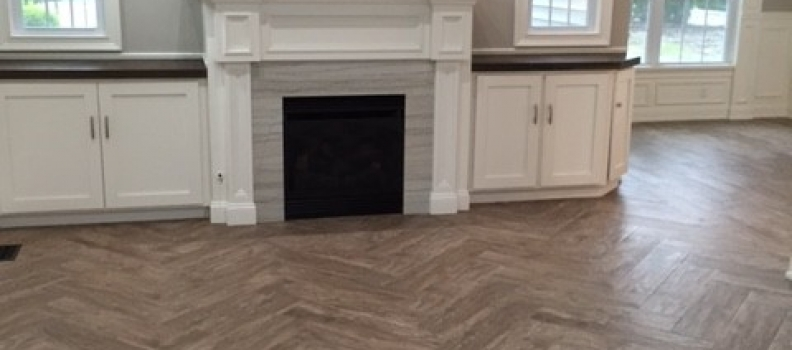 Wood Floor tile installed in a herringbone pattern
