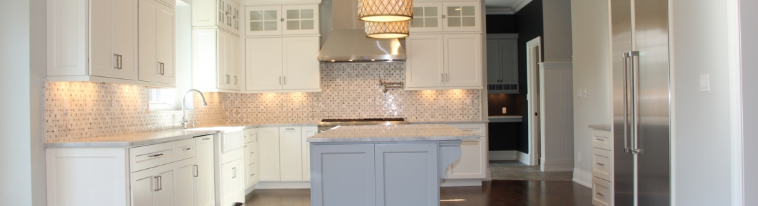 Marble Mosaic Backsplash with Carrara Marble Countertops