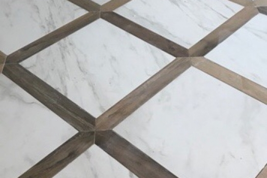Porcelain wood tile wrapped around 24×24 Porcealin calacatta
