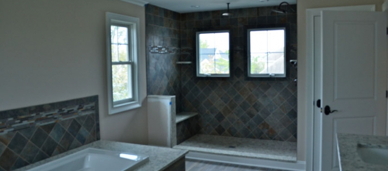 Porcelain Slate Tile Shower Wall and Wood Tile Bathroom Floors